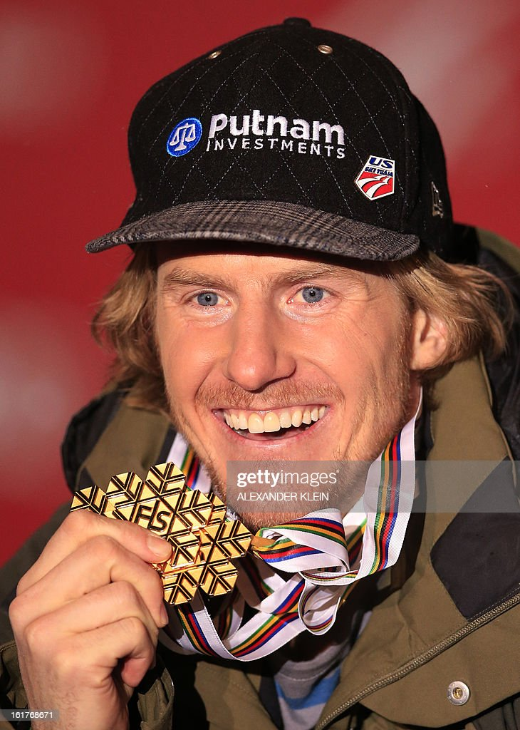 Gold medal winner Ted Ligety of the US poses with his medals on the podium during the medal awards ceremony for the men's Giant slalom at the 2013 Ski World Championships in Schladming on February 15, 2013.