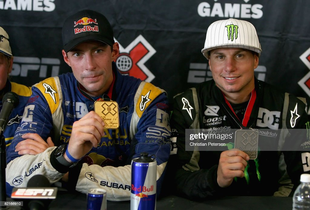 Gold medal winner Travis Pastrana and bronze medal winner <a gi-track='captionPersonalityLinkClicked' href=/galleries/search?phrase=Dave+Mirra+-+BMX+Biker+and+Race+Car+Driver&family=editorial&specificpeople=2231097 ng-click='$event.stopPropagation()'>Dave Mirra</a> pose together after the Rally Car race during the summer X Games 14 at Home Depot Center on August 3, 2008 in Carson, California.