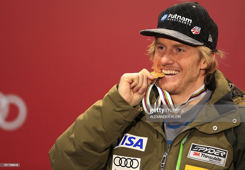 Gold medal winner US Ted Ligety poses with his medals on the podium during the medal awards ceremony for the men's Giant slalom at the 2013 Ski World Championships in Schladming, Austria on February 15, 2013. KLEIN