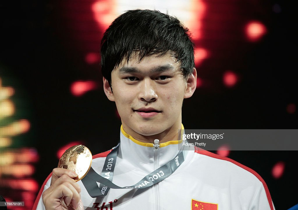 Gold medal winner Yang Sun of China celebrates on the podium after the Swimming Men's Freestyle 1500m Final on day sixteen of the 15th FINA World Championships at Palau Sant Jordi on August 4, 2013 in Barcelona, Spain.