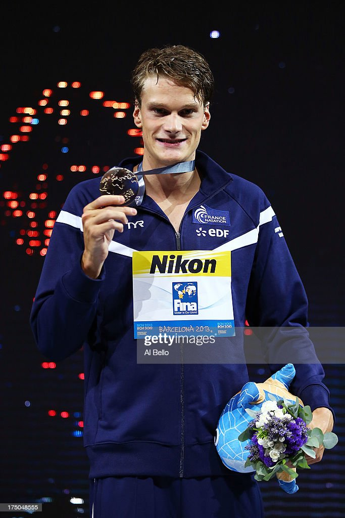 Gold medal winner <a gi-track='captionPersonalityLinkClicked' href=/galleries/search?phrase=Yannick+Agnel&family=editorial&specificpeople=6567514 ng-click='$event.stopPropagation()'>Yannick Agnel</a> of France celebrates on the podium after winning the Swimming Men's 200m Freestyle Final on day eleven of the 15th FINA World Championships at Palau Sant Jordi on July 30, 2013 in Barcelona, Spain.