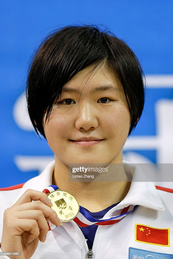 Gold medal winner <a gi-track='captionPersonalityLinkClicked' href=/galleries/search?phrase=Ye+Shiwen&family=editorial&specificpeople=7402437 ng-click='$event.stopPropagation()'>Ye Shiwen</a> celebrates on the podium after the Women's 400 meters individual medley final on day eight of the China National Swimming Championships on April 16, 2015 in Baoji, Shanxi Province, China.