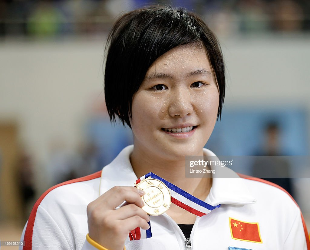Gold medal winner <a gi-track='captionPersonalityLinkClicked' href=/galleries/search?phrase=Ye+Shiwen&family=editorial&specificpeople=7402437 ng-click='$event.stopPropagation()'>Ye Shiwen</a> of China celebrates on the podium after the Women's 200 meters individual medley finals on day two of the China National Swimming Championships on April 10, 2015 in Baoji, Shanxi Province, China.