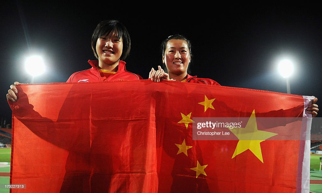 Gold Medal winner Yuchen Xie of China (L) and Bronze medal winner Xinyun Liand of China celebrate in the Girls Discus Throw Final during Day 1 of the IAAF World Youth Championships at the RSC Olimpiyskiy Stadium on July 10, 2013 in Donetsk, Ukraine.