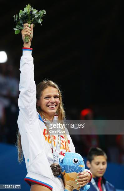 Gold medal winner Yuliya Efimova of Russia celebrates on the podium after the Swimming Women's Breaststroke 200m Final on day fourteen of the 15th...