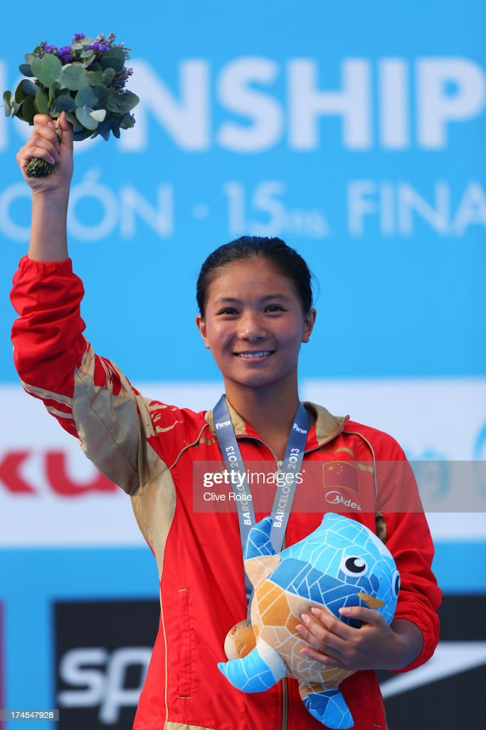 Gold medal winner Zi He of China celebrates after the Women's 3m Springboard Diving Semifinal round on day eight of the 15th FINA World Championships at Piscina Municipal de Montjuic on July 27, 2013 in Barcelona, Spain.