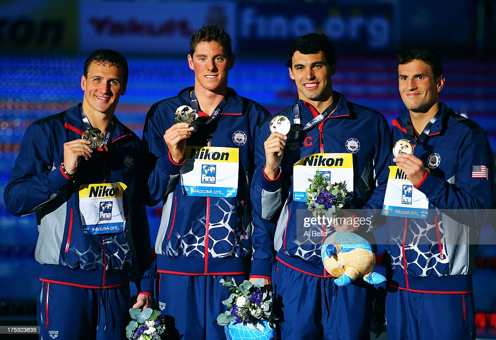 Gold medal winners <a gi-track='captionPersonalityLinkClicked' href=/galleries/search?phrase=Conor+Dwyer&family=editorial&specificpeople=7988001 ng-click='$event.stopPropagation()'>Conor Dwyer</a>, <a gi-track='captionPersonalityLinkClicked' href=/galleries/search?phrase=Ryan+Lochte&family=editorial&specificpeople=182557 ng-click='$event.stopPropagation()'>Ryan Lochte</a>, Charlie Houchin and <a gi-track='captionPersonalityLinkClicked' href=/galleries/search?phrase=Ricky+Berens&family=editorial&specificpeople=5420691 ng-click='$event.stopPropagation()'>Ricky Berens</a> of the USA celebrate on the podium after the Men's Freestyle 4x200m Final on day fourteen of the 15th FINA World Championships at Palau Sant Jordi on August 2, 2013 in Barcelona, Spain.