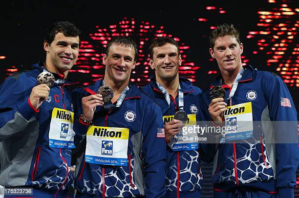 Gold medal winners Conor Dwyer Ryan Lochte Charlie Houchin and Ricky Berens of the USA celebrate on the podium after the Men's Freestyle 4x200m Final...