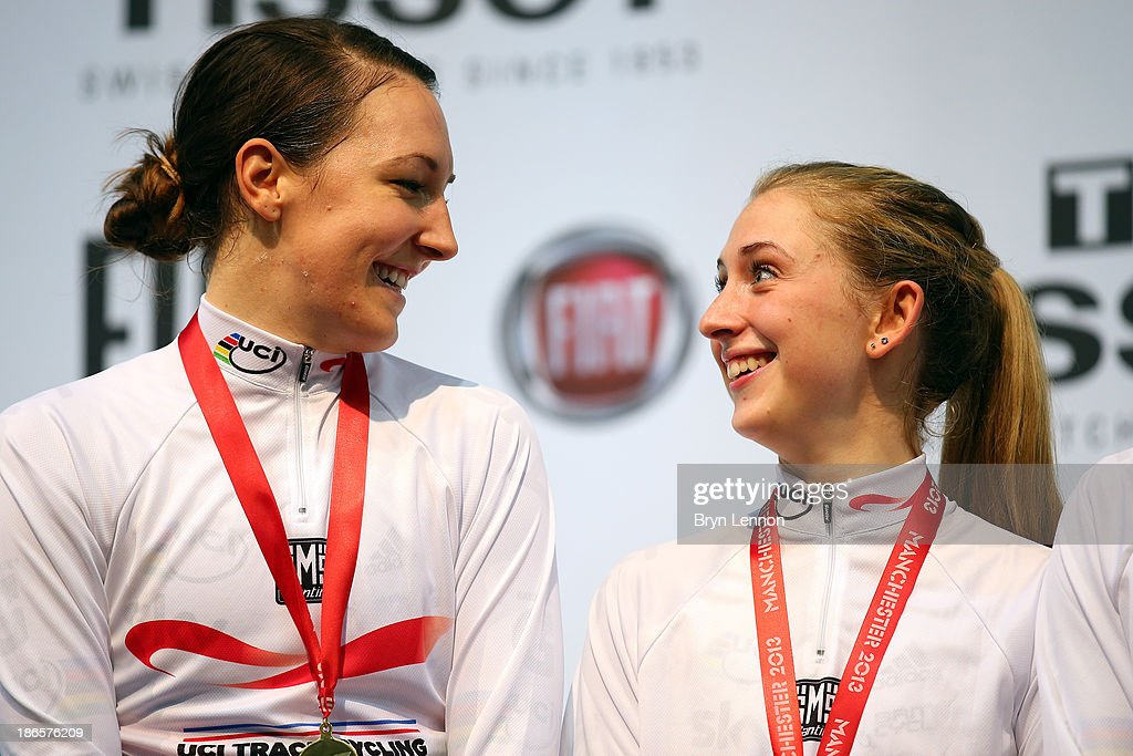 Gold medal winners Dani King and Laura Trott of Great Britain celebrate on the podium after the Women's Team Pursuit Finals on day one of the UCI Track Cycling World Cup at Manchester Velodrome on November 1, 2013 in Manchester, England.