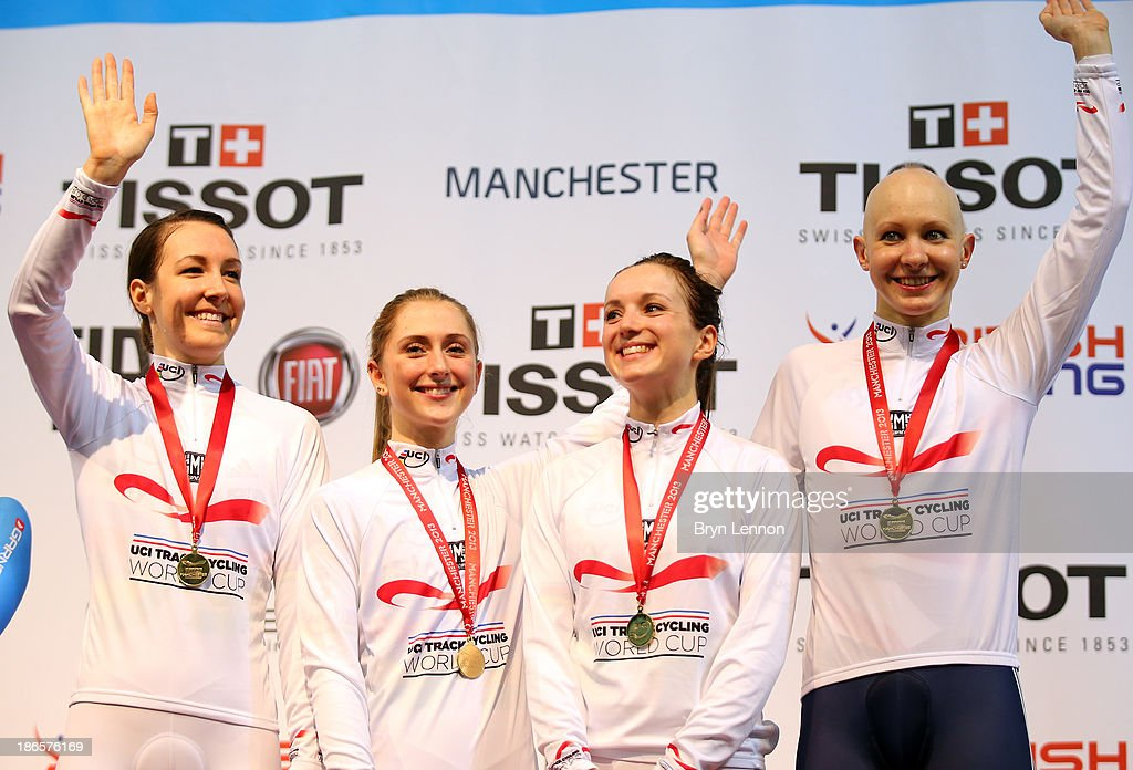 Gold medal winners Dani King, Laura Trott, Elinor Barker and Joanna Rowsell of Great Britain celebrate on the podium after the Women's Team Pursuit Finals on day one of the UCI Track Cycling World Cup at Manchester Velodrome on November 1, 2013 in Manchester, England.