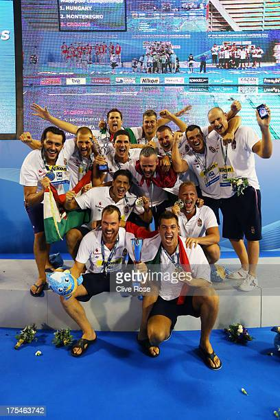 Gold medal winners Hungary celebrate on the podium after the Men's Water Polo Men's Gold Medal Match between Hungary and Montenegro on day fifteen of...