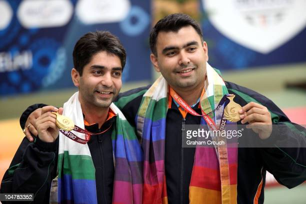 Gold medal winners in the Mens 10m Air Rifle Pairs Abhinav Bindra and Gagan Narang of India pose with their medals at Dr Karni Singh Shooting Range...