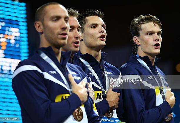 Gold medal winners Jeremy Stravius Fabien Gilot Florent Manaudou and Yannick Agnel of France celebrate after the Swimming Men's 4x100m Freestyle on...