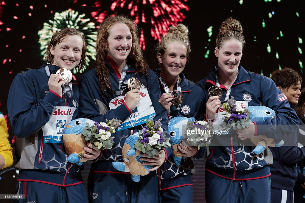 Gold medal winners <a gi-track='captionPersonalityLinkClicked' href=/galleries/search?phrase=Katie+Ledecky&family=editorial&specificpeople=9595921 ng-click='$event.stopPropagation()'>Katie Ledecky</a>, <a gi-track='captionPersonalityLinkClicked' href=/galleries/search?phrase=Shannon+Vreeland&family=editorial&specificpeople=6738252 ng-click='$event.stopPropagation()'>Shannon Vreeland</a>, Karlee Delane Bispo and <a gi-track='captionPersonalityLinkClicked' href=/galleries/search?phrase=Missy+Franklin&family=editorial&specificpeople=6623958 ng-click='$event.stopPropagation()'>Missy Franklin</a> of the USA celebrate on the podium after the Swimming Women's Freestyle 4x200m Final on day thirteen of the 15th FINA World Championships at Palau Sant Jordi on August 1, 2013 in Barcelona, Spain.