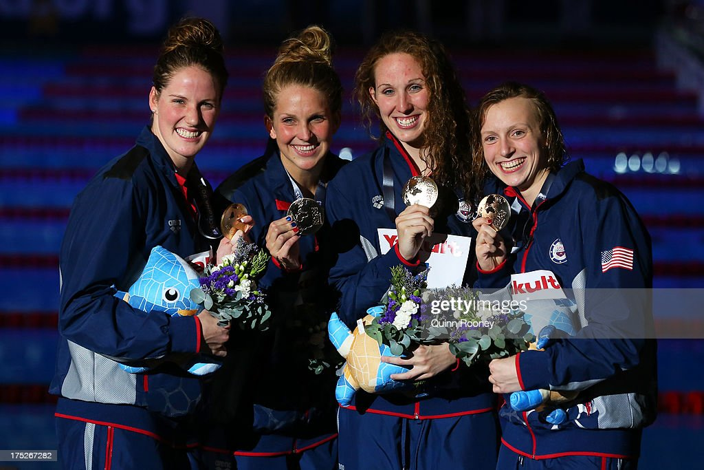 Gold medal winners <a gi-track='captionPersonalityLinkClicked' href=/galleries/search?phrase=Katie+Ledecky&family=editorial&specificpeople=9595921 ng-click='$event.stopPropagation()'>Katie Ledecky</a>, <a gi-track='captionPersonalityLinkClicked' href=/galleries/search?phrase=Shannon+Vreeland&family=editorial&specificpeople=6738252 ng-click='$event.stopPropagation()'>Shannon Vreeland</a>, Karlee Delane Bispo and <a gi-track='captionPersonalityLinkClicked' href=/galleries/search?phrase=Missy+Franklin&family=editorial&specificpeople=6623958 ng-click='$event.stopPropagation()'>Missy Franklin</a> of the USA celebrate poolside after the Swimming Women's Freestyle 4x200m Final on day thirteen of the 15th FINA World Championships at Palau Sant Jordi on August 1, 2013 in Barcelona, Spain.