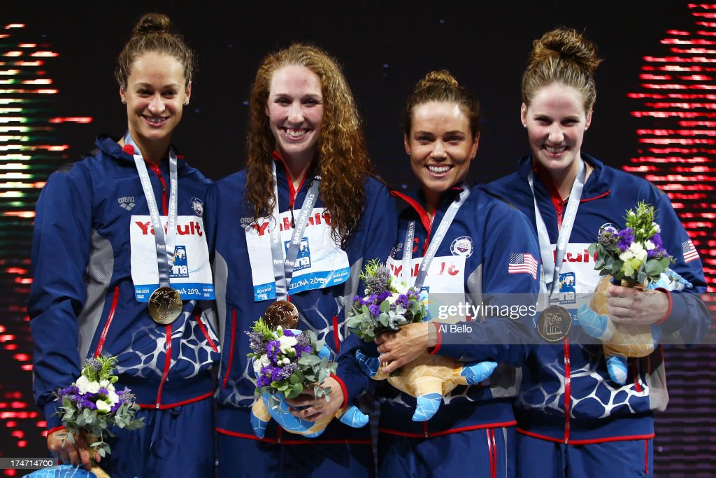 Gold Medal winners Megan Romano, Shannon Vreeland, Natalie Coughlin and Missy Franklin of the USA celebrate on the podium after the Swimming Women's4x100mFreestyle on day nine of the 15th FINA World Championships at Palau Sant Jordi on July 28, 2013 in Barcelona, Spain.
