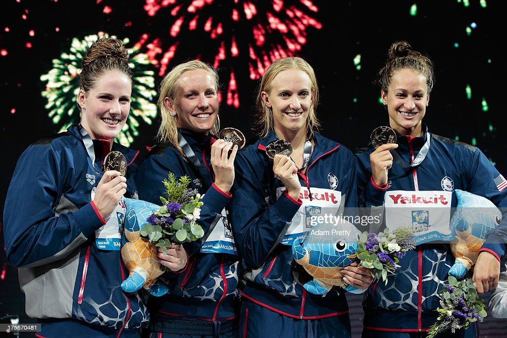 Gold medal winners <a gi-track='captionPersonalityLinkClicked' href=/galleries/search?phrase=Missy+Franklin&family=editorial&specificpeople=6623958 ng-click='$event.stopPropagation()'>Missy Franklin</a>, <a gi-track='captionPersonalityLinkClicked' href=/galleries/search?phrase=Jessica+Hardy&family=editorial&specificpeople=540355 ng-click='$event.stopPropagation()'>Jessica Hardy</a>, <a gi-track='captionPersonalityLinkClicked' href=/galleries/search?phrase=Dana+Vollmer&family=editorial&specificpeople=240582 ng-click='$event.stopPropagation()'>Dana Vollmer</a> and Megan Romano of the USA celebrate on the podium after the Swimming Women's Medley 4x100m Relay Final on day sixteen of the 15th FINA World Championships at Palau Sant Jordi on August 4, 2013 in Barcelona, Spain.