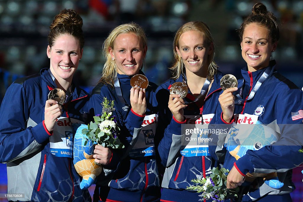 Gold medal winners <a gi-track='captionPersonalityLinkClicked' href=/galleries/search?phrase=Missy+Franklin+-+Swimmer&family=editorial&specificpeople=6623958 ng-click='$event.stopPropagation()'>Missy Franklin</a>, <a gi-track='captionPersonalityLinkClicked' href=/galleries/search?phrase=Jessica+Hardy&family=editorial&specificpeople=540355 ng-click='$event.stopPropagation()'>Jessica Hardy</a>, <a gi-track='captionPersonalityLinkClicked' href=/galleries/search?phrase=Dana+Vollmer&family=editorial&specificpeople=240582 ng-click='$event.stopPropagation()'>Dana Vollmer</a> and Megan Romano of the USA celebrate on the podium after the Swimming Women's Medley 4x100m Relay Final on day sixteen of the 15th FINA World Championships at Palau Sant Jordi on August 4, 2013 in Barcelona, Spain.
