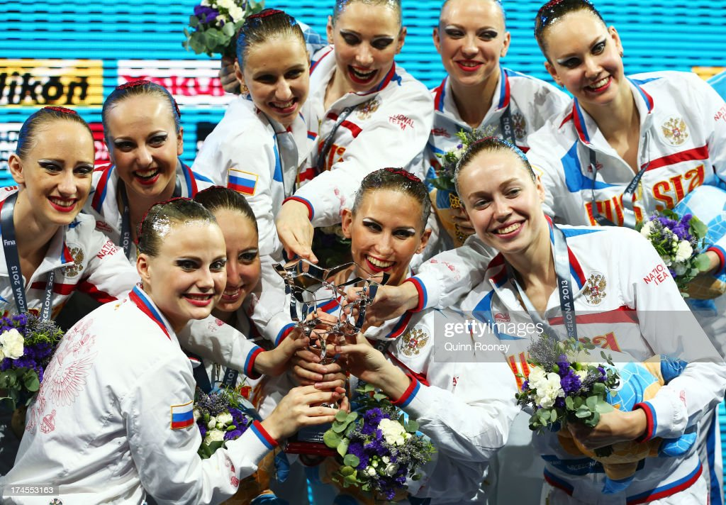 Gold medal winners Russia celebrate and pose with their award for Best National Federation after winning the Synchronized Swimming Free Combination Final on day eight of the 15th FINA World Championships at Palau Sant Jordi on July 27, 2013 in Barcelona, Spain.
