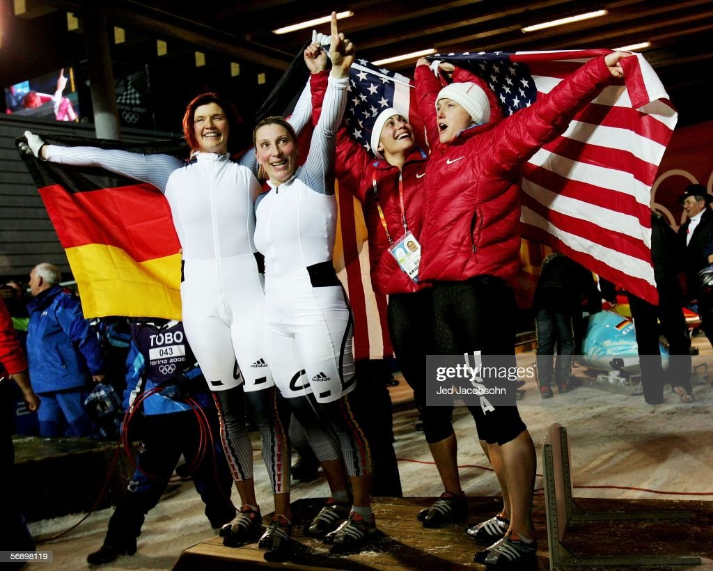 Gold Medal winners Sandra Kiriasis and Anja Schneiderheinze of Germany 1 celebrate with Silver Medal winners Valerie Fleming and Shauna Rohbock of...
