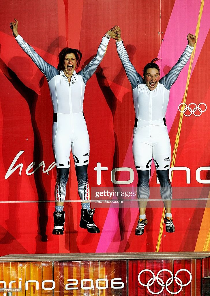 Gold Medal winners Sandra Kiriasis and Anja Schneiderheinze of Germany 1 jump up in celebration on the podium after the Two Woman Bobsleigh Final on...