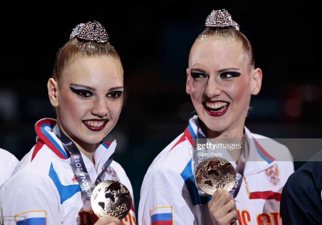 Gold medal winners <a gi-track='captionPersonalityLinkClicked' href=/galleries/search?phrase=Svetlana+Kolesnichenko&family=editorial&specificpeople=7986692 ng-click='$event.stopPropagation()'>Svetlana Kolesnichenko</a> and <a gi-track='captionPersonalityLinkClicked' href=/galleries/search?phrase=Svetlana+Romashina&family=editorial&specificpeople=5988166 ng-click='$event.stopPropagation()'>Svetlana Romashina</a> of Russia celebrate on the podium after the Synchronized Swimming Duet Free Final on day six of the 15th FINA World Championships at Palau Sant Jordi on July 25, 2013 in Barcelona, Spain.