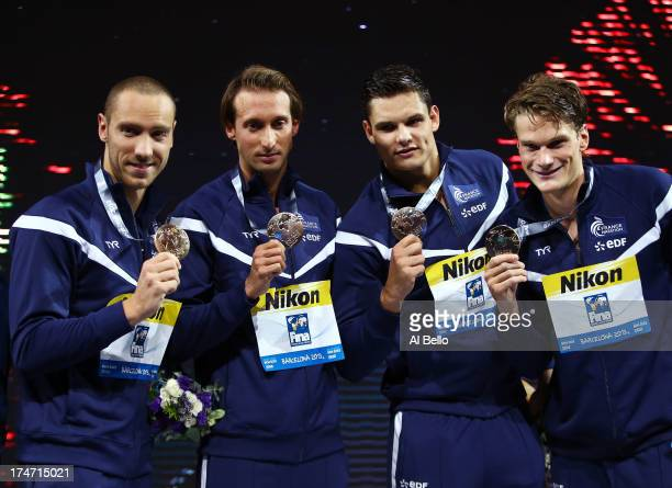 Gold medal winners Yannick Agnel Florent Manaudou Fabien Gilot and Jeremy Stravius of France celebrate on the podium after the Swimming...