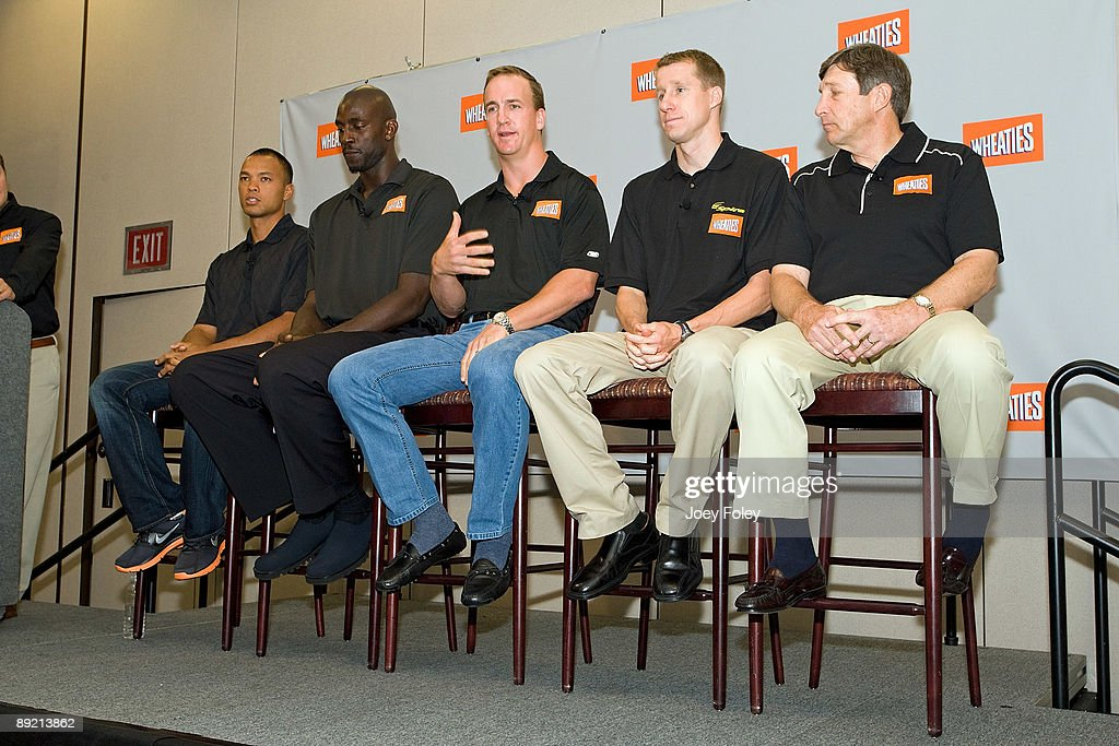 Gold medal winning decathlete Bryan Clay, NBA Basketball star Kevin Garnett, Indianapolis Colts quarterback Peyton Manning, triathlete Hunter Kemper and sports nutritionist Dr. John Ivy, talk about the process of creating a new Wheaties breakfast cereal during a press conference at Conseco Fieldhouse on July 23, 2009 in Indianapolis, Indiana.