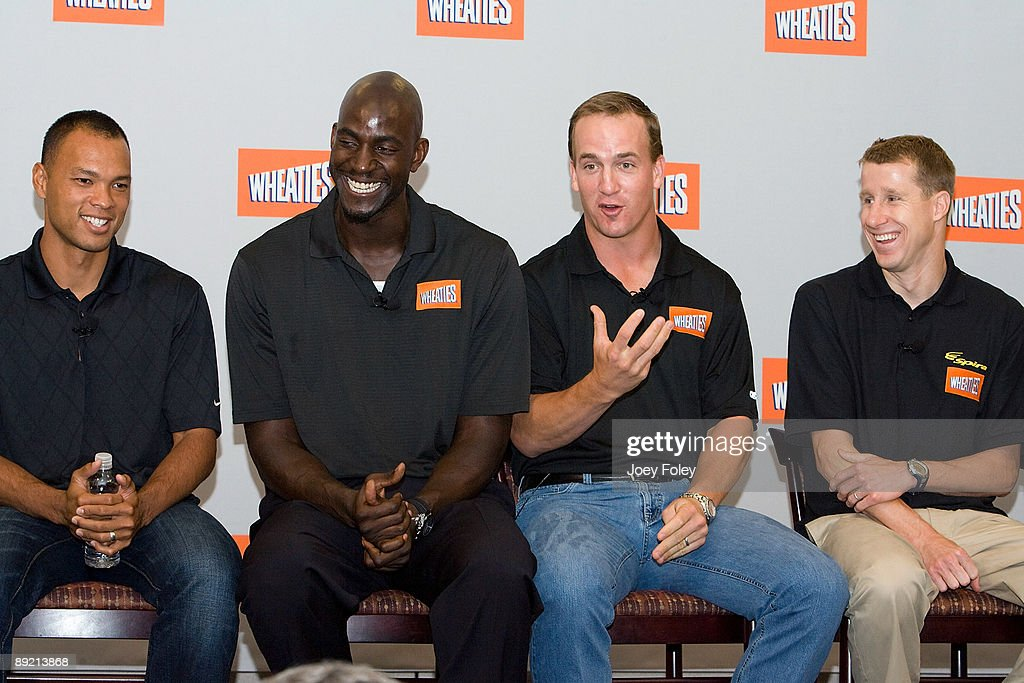 Gold medal winning decathlete Bryan Clay, NBA Basketball star Kevin Garnett, Indianapolis Colts quarterback Peyton Manning, and triathlete Hunter Kemper talk about the process of creating a new Wheaties breakfast cereal during a press conference at Conseco Fieldhouse on July 23, 2009 in Indianapolis, Indiana.