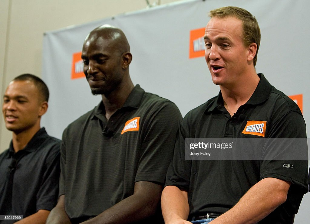 Gold medal winning decathlete Bryan Clay, NBA star Kevin Garnett, and Indianapolis Colts quarterback Peyton Manning talk about the process of creating a new Wheaties breakfast cereal during a press conference at Conseco Fieldhouse on July 23, 2009 in Indianapolis, Indiana.