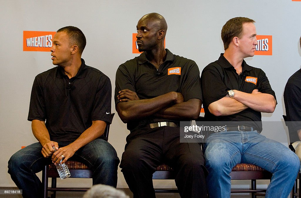 Gold medal winning decathlete Bryan Clay, NBA star Kevin Garnett, and Indianapolis Colts quarterback <a gi-track='captionPersonalityLinkClicked' href=/galleries/search?phrase=Peyton+Manning&family=editorial&specificpeople=184524 ng-click='$event.stopPropagation()'>Peyton Manning</a> as they watch a promotional video of a new version of Wheaties at Conseco Fieldhouse on July 23, 2009 in Indianapolis, Indiana.