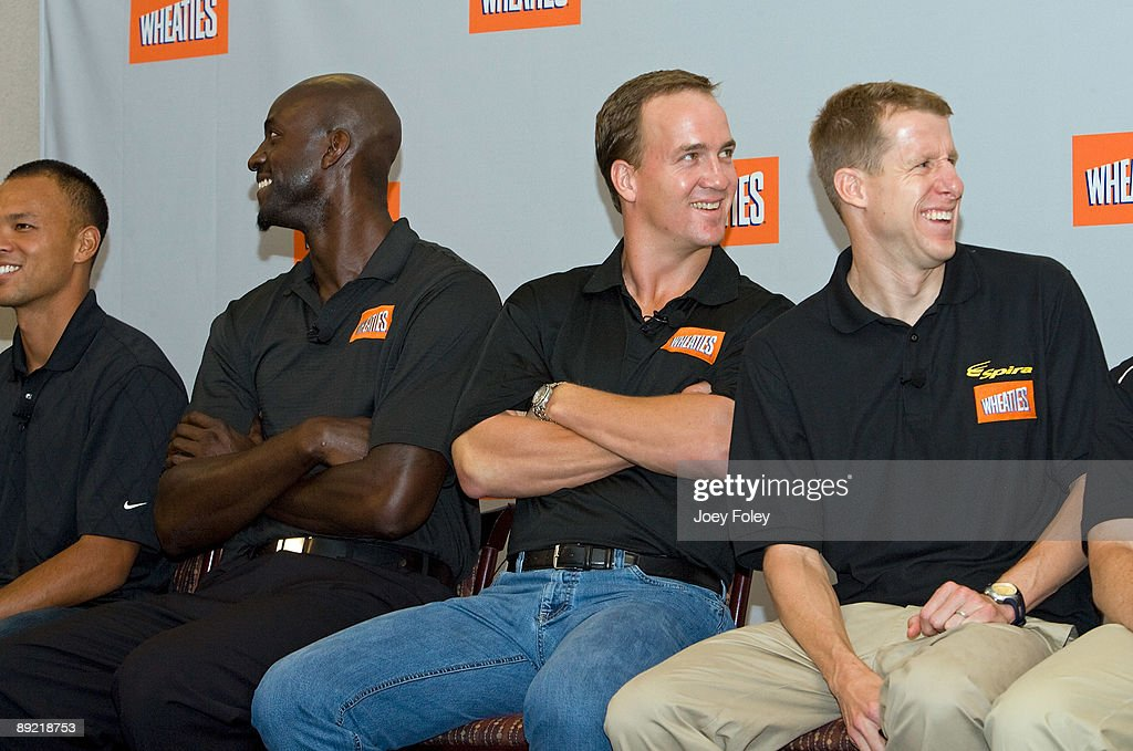 Gold medal winning decathlete Bryan Clay, NBA star Kevin Garnett, Indianapolis Colts quarterback Peyton Manning, and triathlete Hunter Kemper laugh as they watch a promotional video of a new version of Wheaties during a press conference at Conseco Fieldhouse on July 23, 2009 in Indianapolis, Indiana.