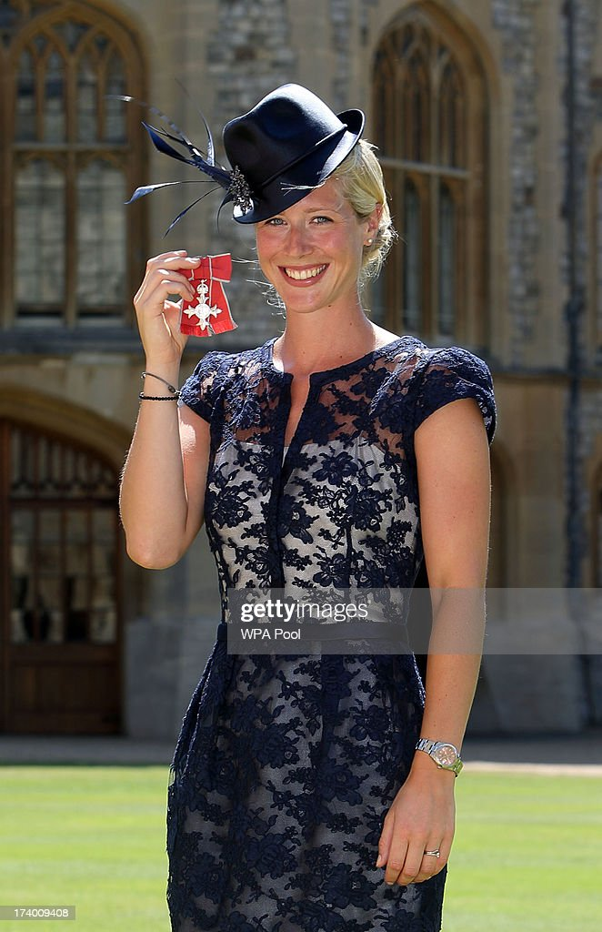Gold medal winning Olympic Dressage rider Laura Tomlinson after she is made a Member of the Order of the British Empire by Queen Elizabeth II during...