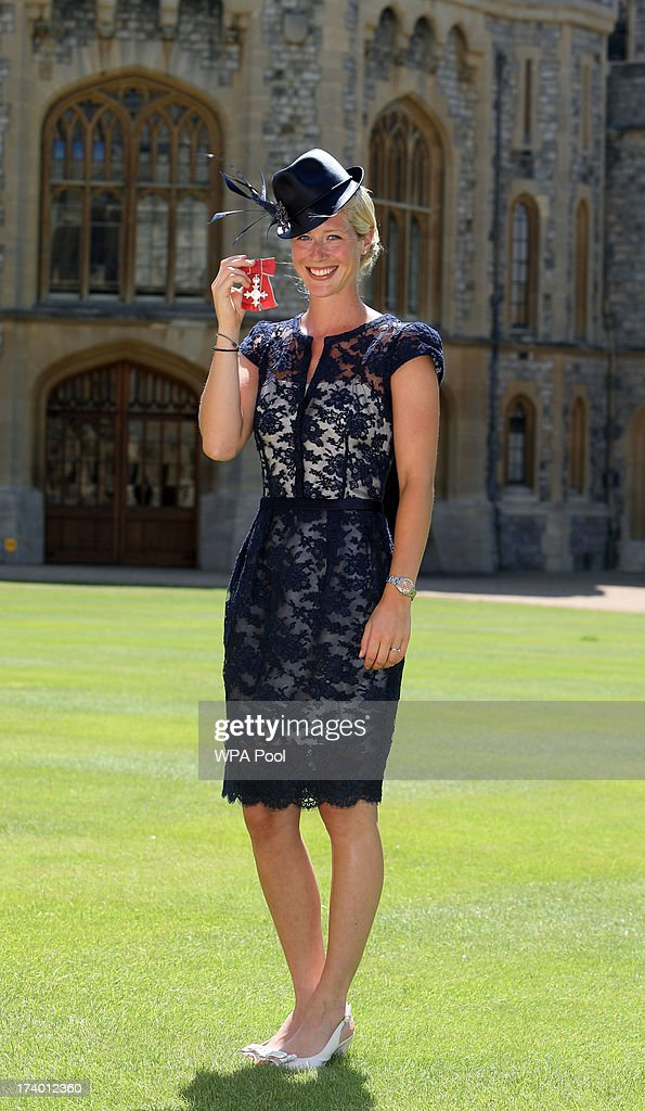 Gold medal winning Olympic Dressage rider Laura Tomlinson after she is made a Member of the Order of the British Empire (MBE) by Queen Elizabeth II during an Investiture ceremony at Windsor Castle on July 19, 2013 in Windsor, England.