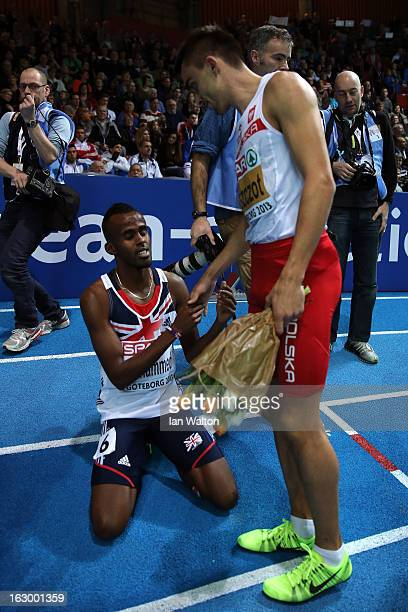 Gold medalist Adam Kszczot of Poland congratulates Bronze medalist Mukhtar Mohammed of Great Britain after the Men's 800m Finalduring day three of...