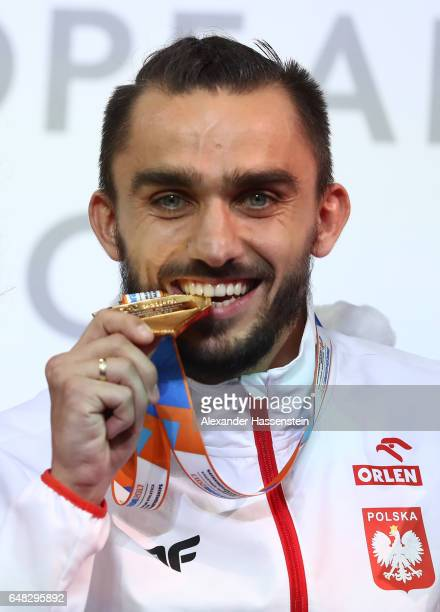 Gold medalist Adam Kszczot of Poland poses during the medal ceremony for the Men's 800 metres on day three of the 2017 European Athletics Indoor...
