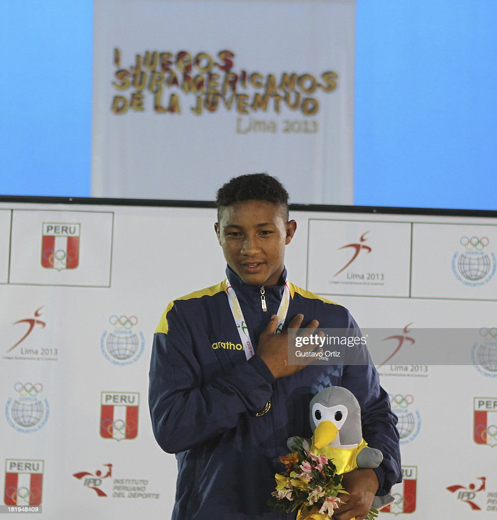 Gold medalist Adam Paez of Ecuador in the podium of Greco Roman 69kg as part of the I ODESUR South American Youth Games at Polideportivo Villa Deportiva del Callao on September 26, 2013 in Lima, Peru.