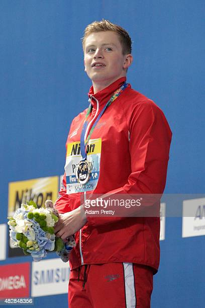 Gold medalist Adam Peaty of Great Britain poses during the medal ceremony for the Men's 100m Breaststroke on day ten of the 16th FINA World...