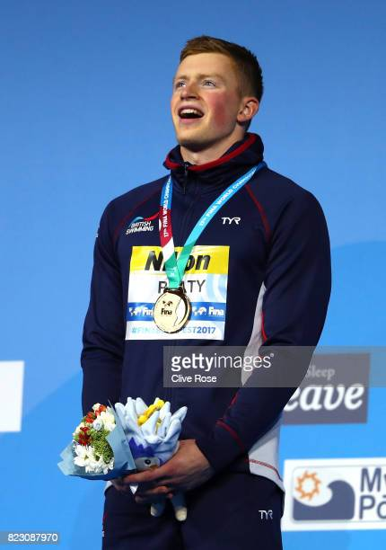 Gold medalist Adam Peaty of Great Britain poses with the medal won during the Men's 50m Breaststroke finalon day thirteen of the Budapest 2017 FINA...