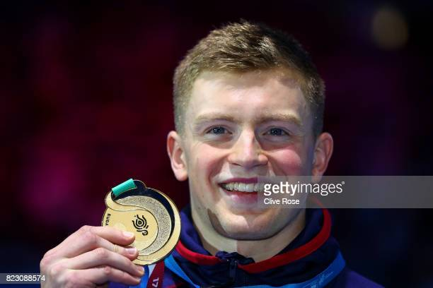 Gold medalist Adam Peaty of Great Britain poses with the medal won during the Men's 50m Breaststroke final on day thirteen of the Budapest 2017 FINA...