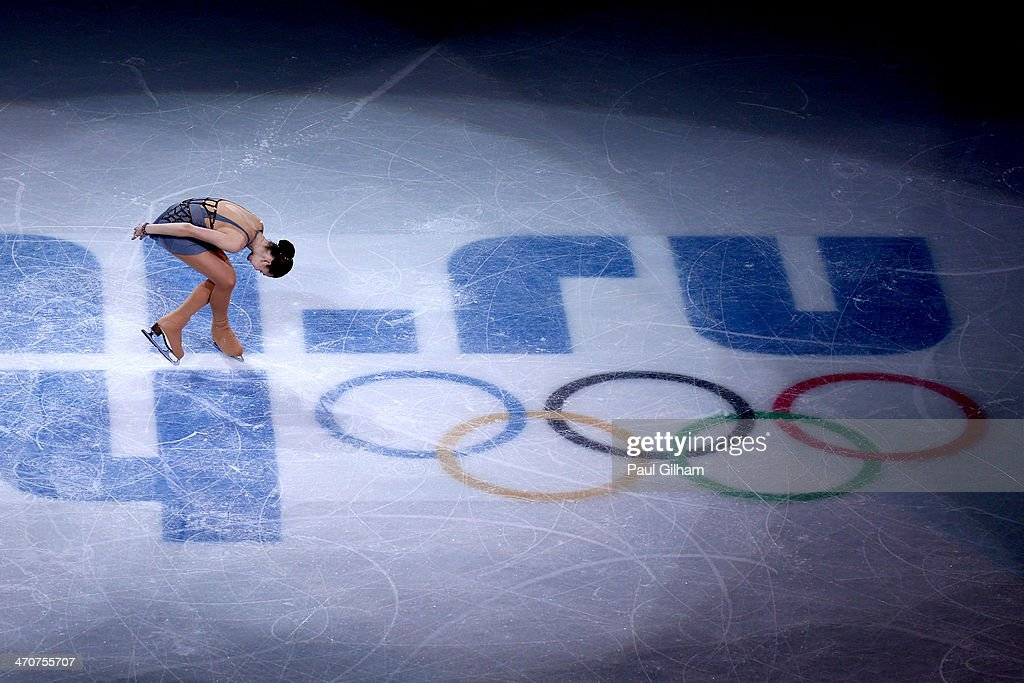 Gold medalist <a gi-track='captionPersonalityLinkClicked' href=/galleries/search?phrase=Adelina+Sotnikova&family=editorial&specificpeople=7380612 ng-click='$event.stopPropagation()'>Adelina Sotnikova</a> of Russia celebrates during the flower ceremony for the Ladies' Figure Skating on day 13 of the Sochi 2014 Winter Olympics at Iceberg Skating Palace on February 20, 2014 in Sochi, Russia.