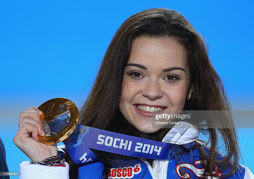 Gold medalist <a gi-track='captionPersonalityLinkClicked' href=/galleries/search?phrase=Adelina+Sotnikova&family=editorial&specificpeople=7380612 ng-click='$event.stopPropagation()'>Adelina Sotnikova</a> of Russia celebrates during the medal ceremony for the Women's Free Figure Skating on day fourteen of the Sochi 2014 Winter Olympics at Medals Plaza on February 21, 2014 in Sochi, Russia.