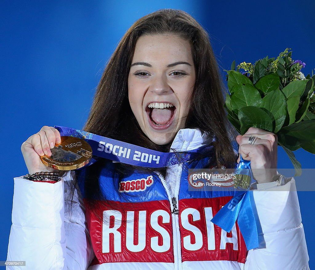 Gold medalist Adelina Sotnikova of Russia celebrates during the medal ceremony for the Women's Free Figure Skating on day fourteen of the Sochi 2014 Winter Olympics at Medals Plaza on February 21, 2014 in Sochi, Russia.