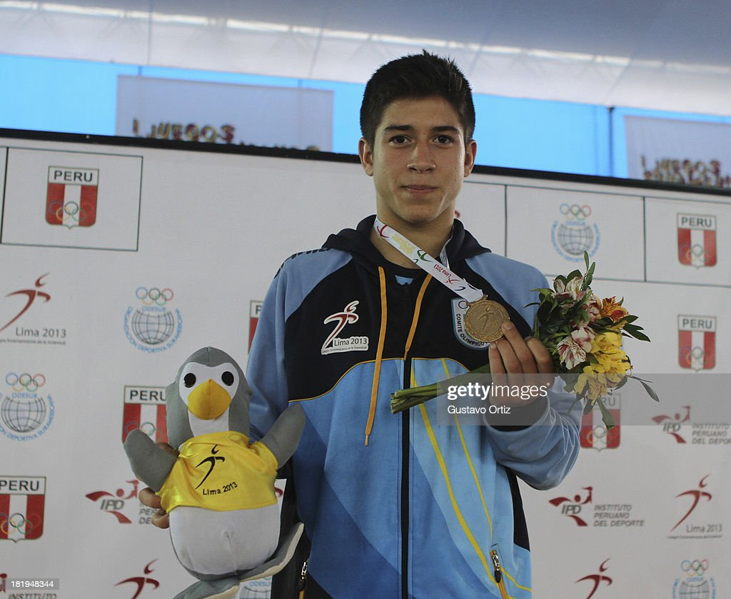 Gold medalist Agustin Destribats of Argentina in the podium of Greco Roman 58kgas part of the I ODESUR South American Youth Games at Polideportivo Villa Deportiva del Callao on September 26, 2013 in Lima, Peru.