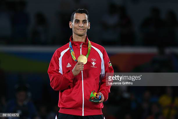 Gold medalist Ahmad Abughaush of Jordan celebrates on the podium after the men's 68kg Gold Medal Taekwondo contest at the Carioca Arena on Day 13 of...