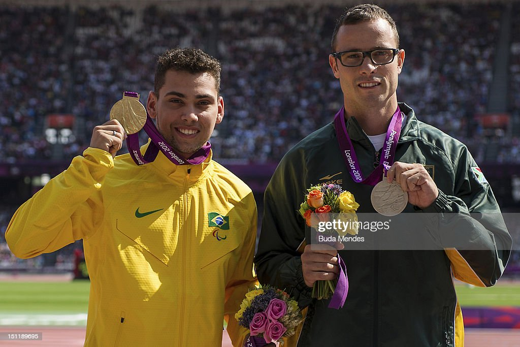 Gold medalist Alan Fonteles Cardoso Oliveira from Brazil and Silver medalist Oscar Pistorius from South Africa at the Olympic Stadium on September 03...