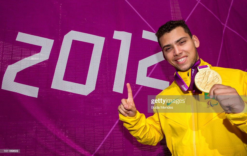 Gold medalist Alan Fonteles Cardoso Oliveira poses for a picture after winning the gold medal of the Men's 200m - T44 race on day 5 of the London 2012 Paralympic Games at the Olympic Stadium on September 03, 2012 in London, England.