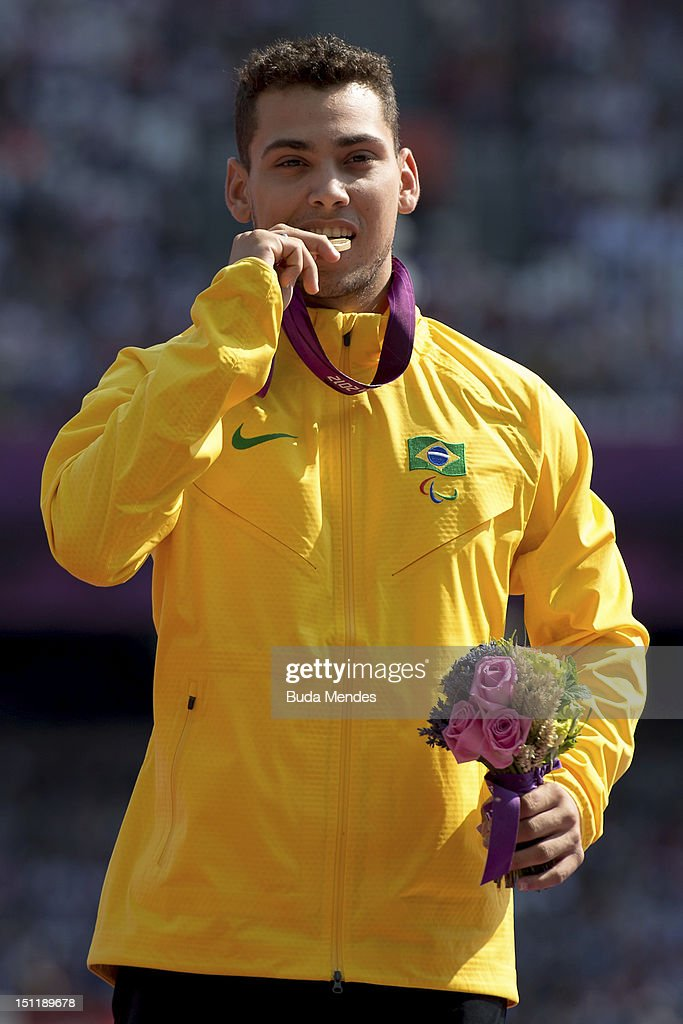 Gold medalist Alan Fonteles Cardoso Oliveira poses on the podium during the award ceremony for the Men's 200m - T44 on day 5 of the London 2012 Paralympic Games at the Olympic Stadium on September 03, 2012 in London, England.
