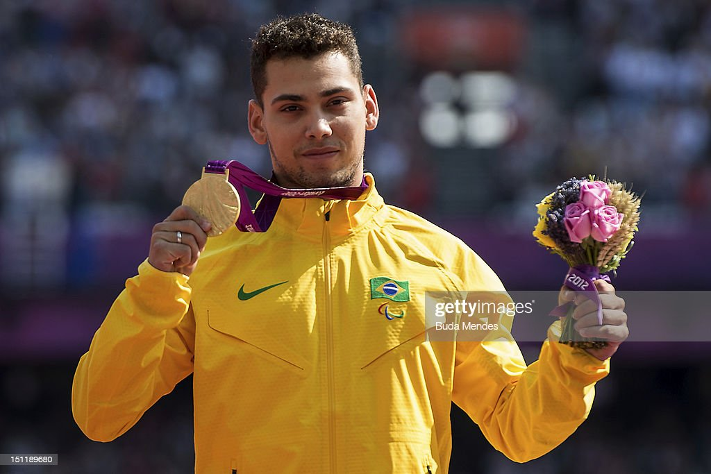 Gold medalist <a gi-track='captionPersonalityLinkClicked' href=/galleries/search?phrase=Alan+Fonteles+Cardoso+Oliveira&family=editorial&specificpeople=9688610 ng-click='$event.stopPropagation()'>Alan Fonteles Cardoso Oliveira</a> poses on the podium during the award ceremony for the Men's 200m - T44 on day 5 of the London 2012 Paralympic Games at the Olympic Stadium on September 03, 2012 in London, England.