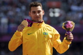 Gold medalist Alan Fonteles Cardoso Oliveira poses on the podium during the award ceremony for the Men's 200m T44 on day 5 of the London 2012...